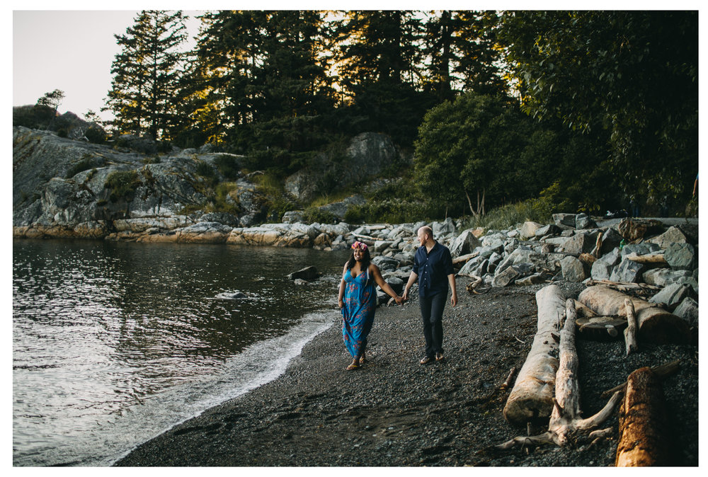 couple walk beach sunset engagement whytecliff park