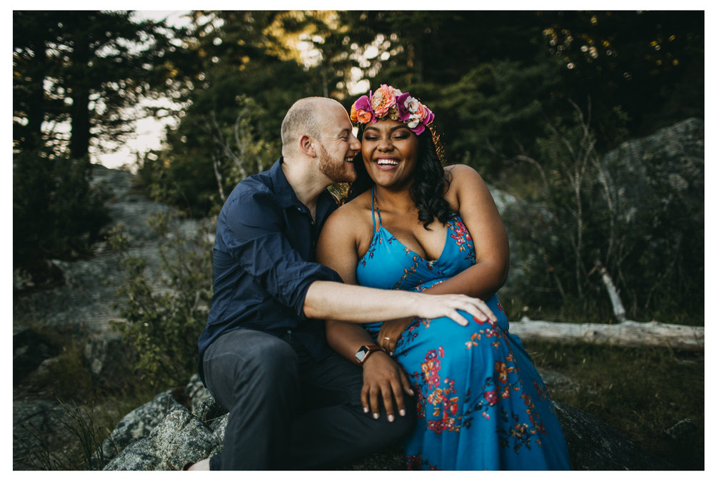 engaged couple snuggle smiling happy engagement whytecliff park