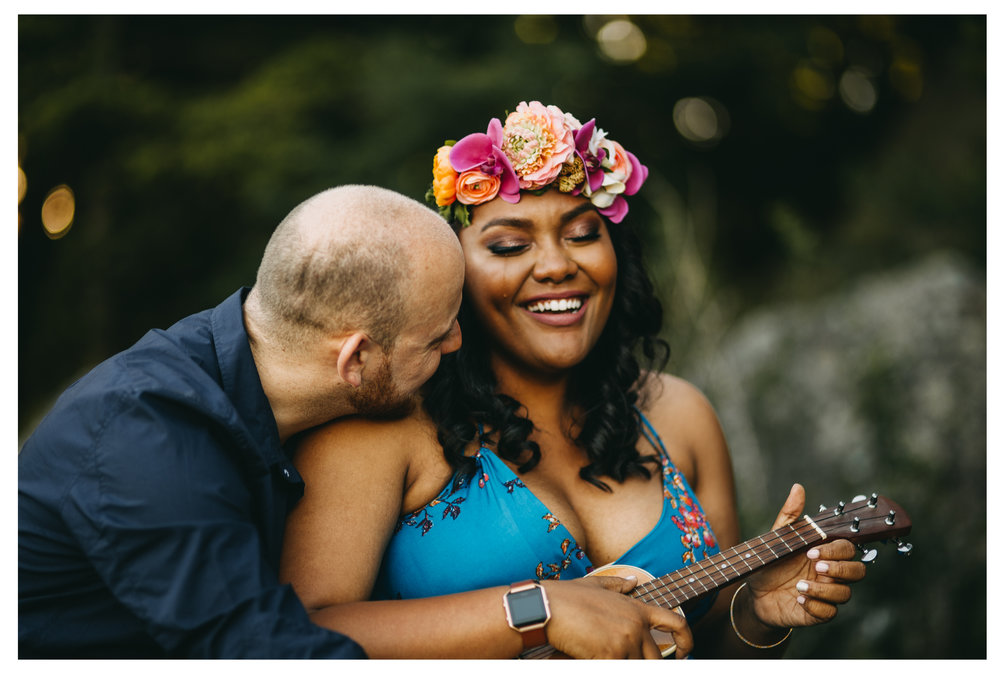 engaged couple playing ukulele while girl cries happy tears
