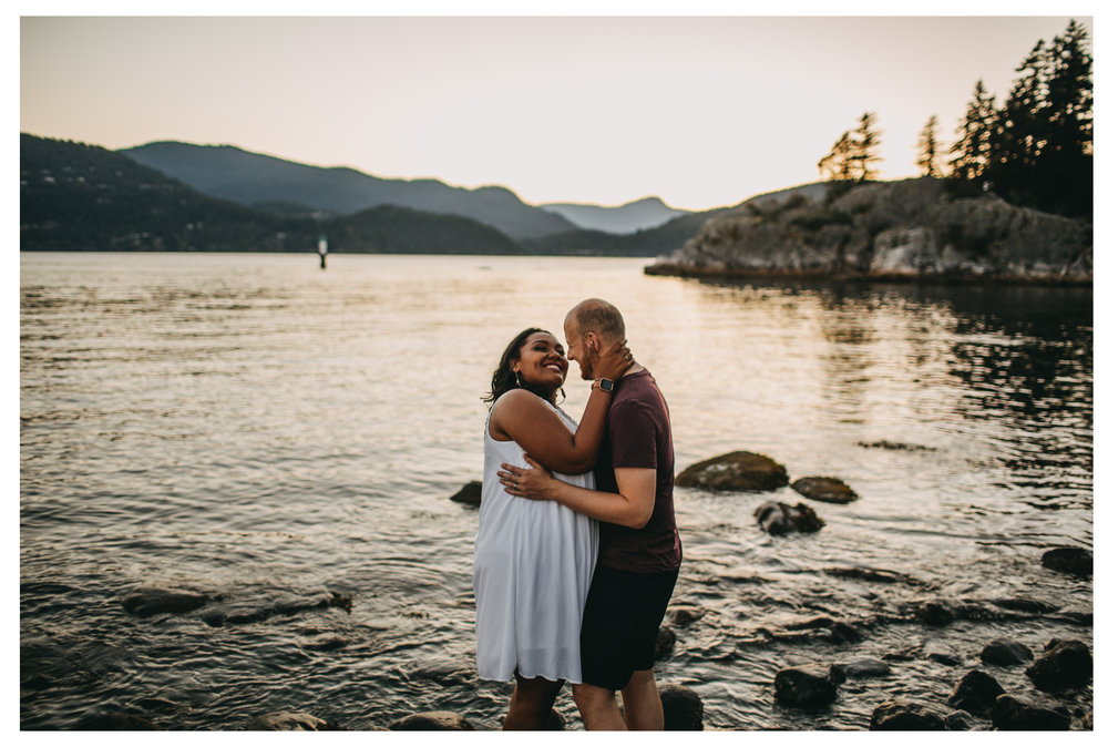 "<img src=""engagement.jpg"" alt=""couple smiling while hugging with ocean behind them during sunset "">"