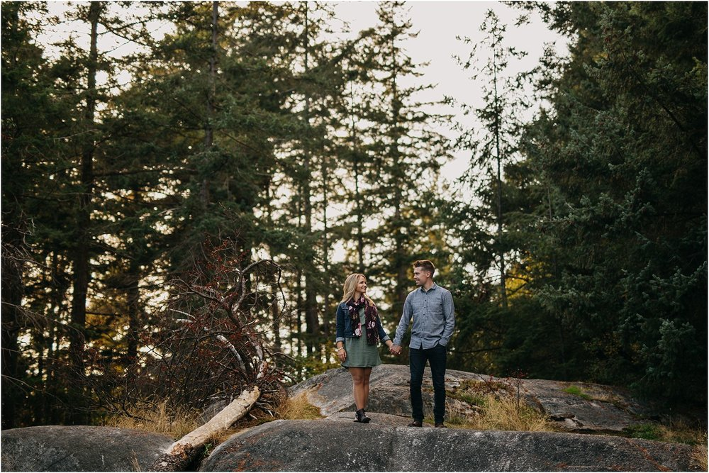 guy and girl holding hands in forest