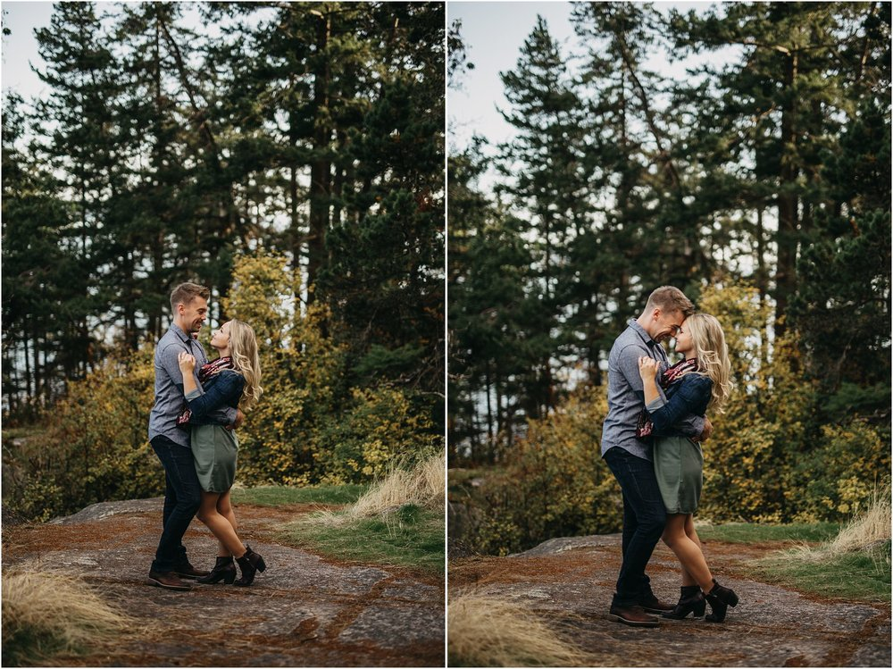 man and woman hugging engagement session
