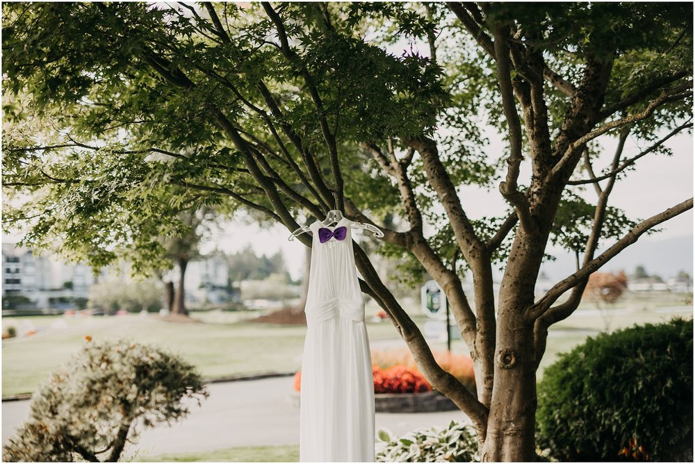 bride wedding dress hanging in tree pitt meadows wedding