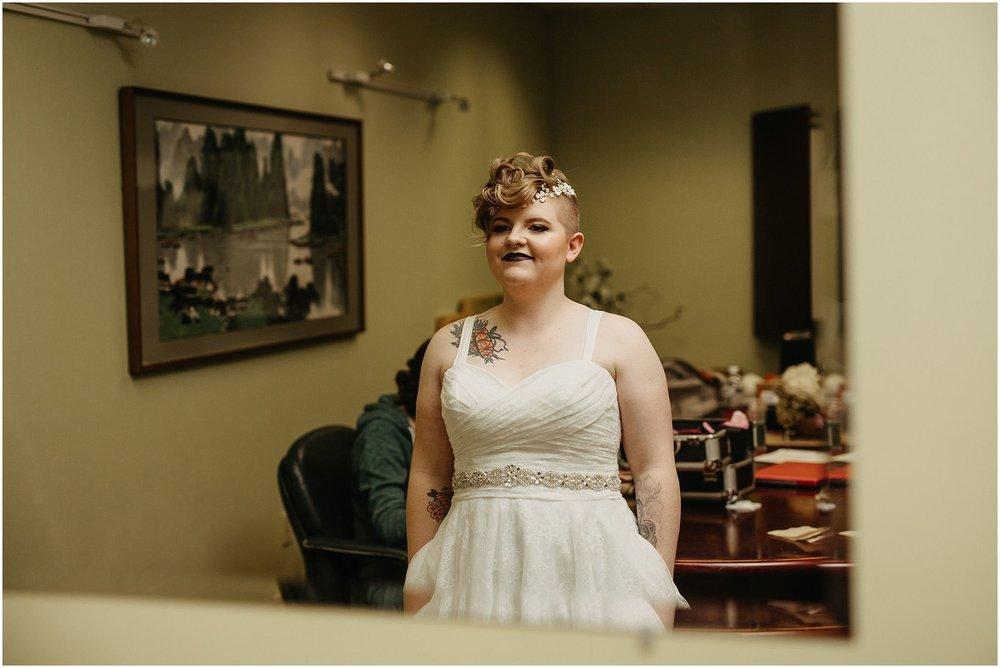 bride in wedding dress looking in mirror pitt meadows wedding