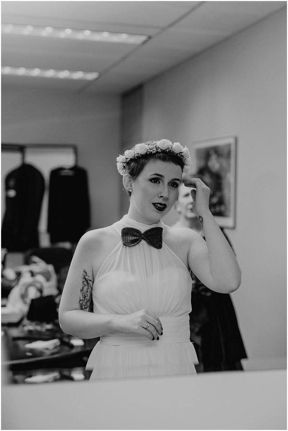 bride looking in mirror wedding dress flower crown