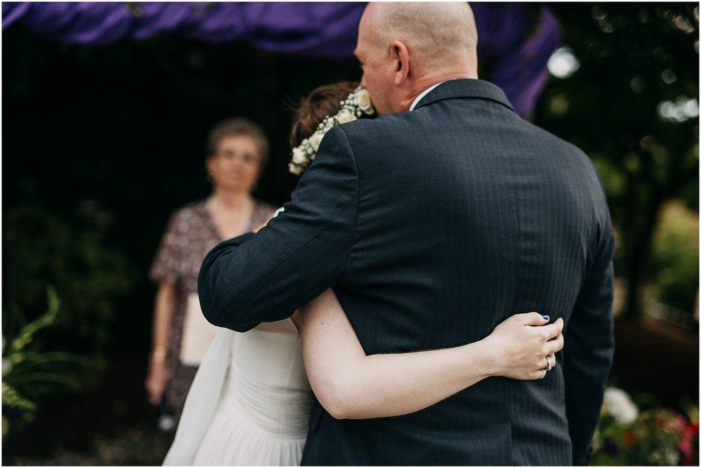father of bride hugging bride at ceremony pitt meadows wedding
