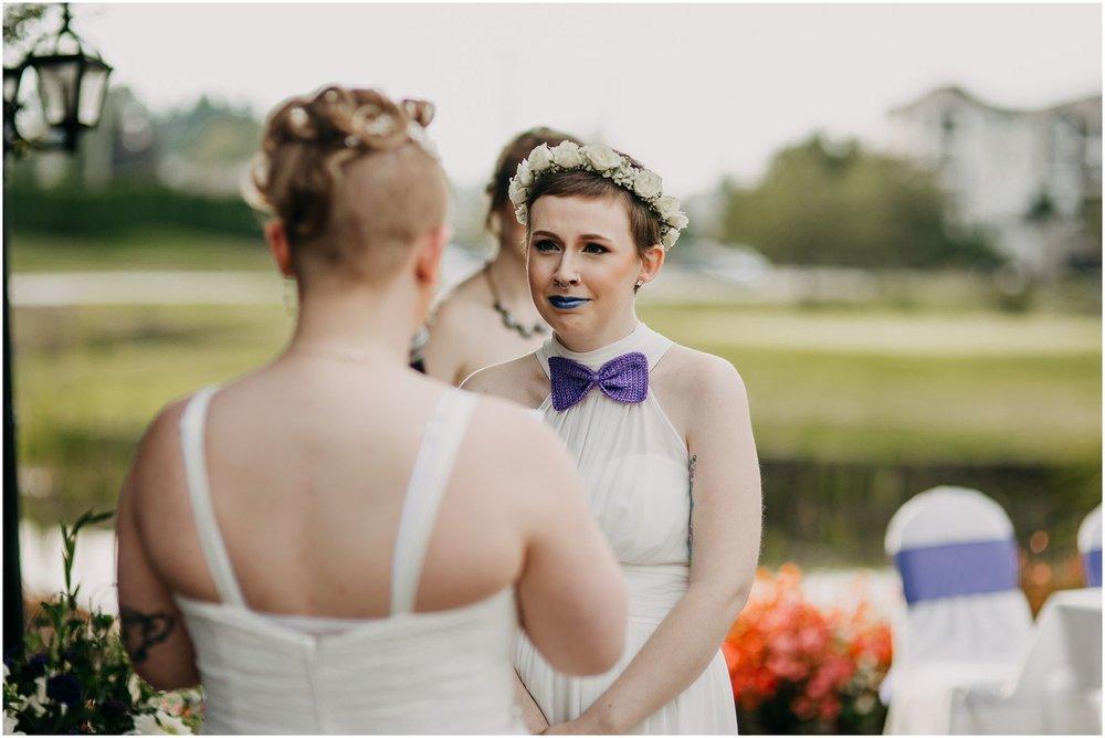 bride exchanging vows spouse reaction same sex couple