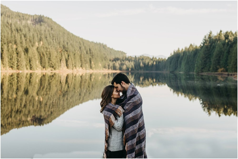 fall engagement photos rolley lake couple wrapped in blanket