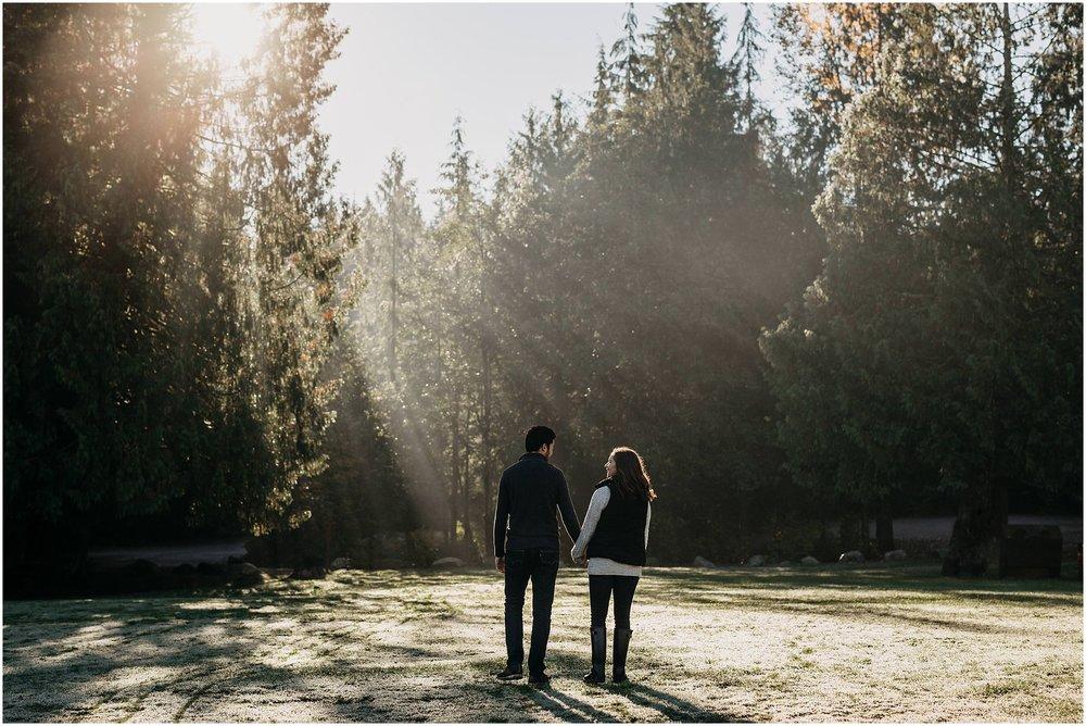 couple engagement session sunshine beam through trees