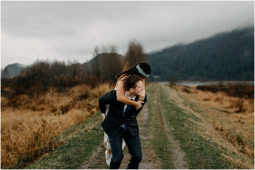 couple piggyback funny candid moment pitt lake engagement