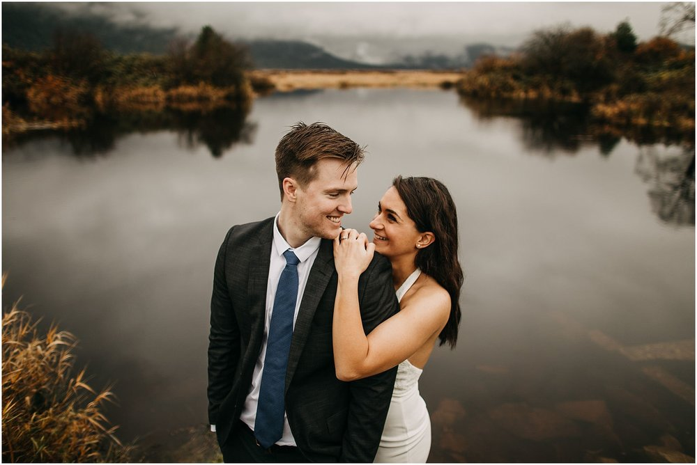 girl's arm draped over guy smiling couple pitt lake engagement