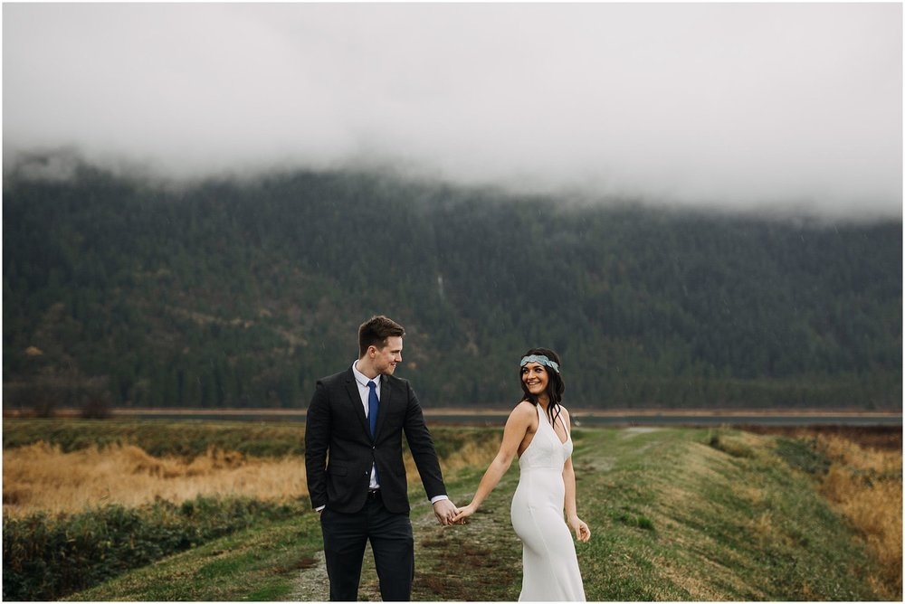 couple holding hands pitt lake engagement flower crown