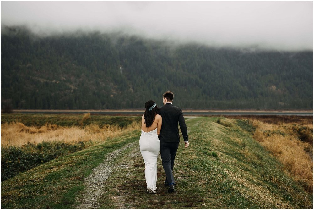 couple walking away pitt lake marsh pnw engagement