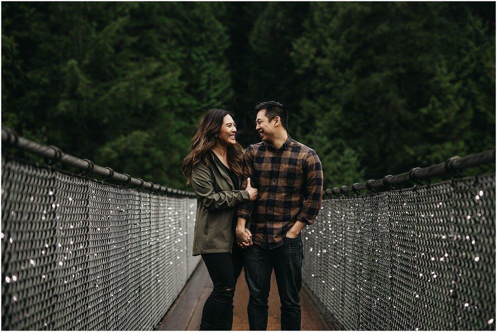 engaged couple on capilano suspension bridge canyon lights engagement photos