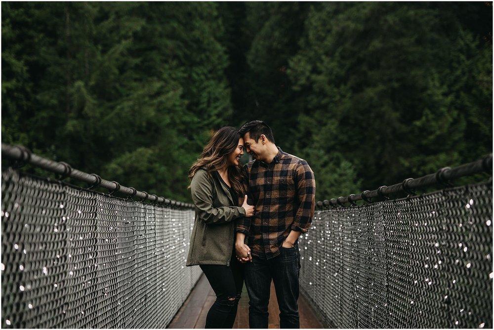 engaged couple on capilano suspension bridge engagement photos