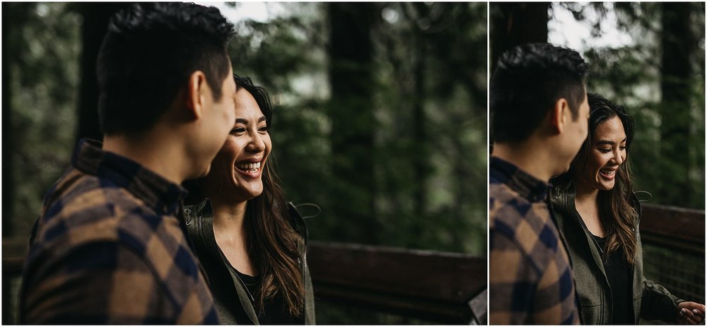 candid moment between couple capilano suspension bridge engagement