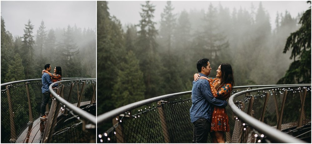 engagement couple on cliffwalk capilano suspension bridge foggy rainy day