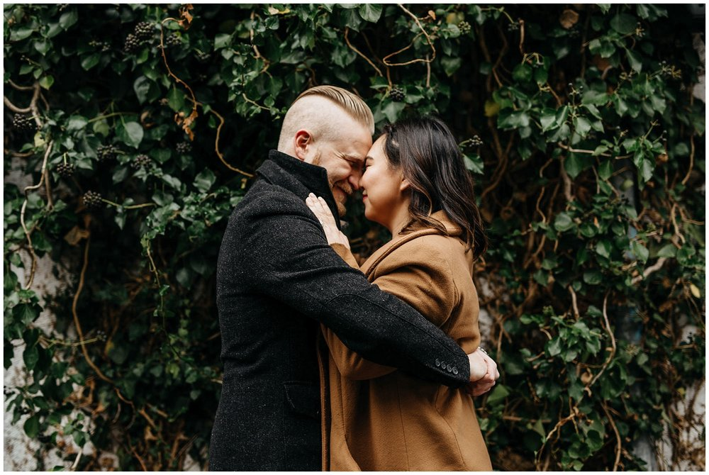 engaged couple vancouver engagement ivy vine wall