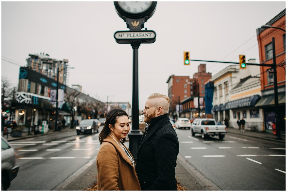 couple in front of mount pleasant clock vancouver city engagement