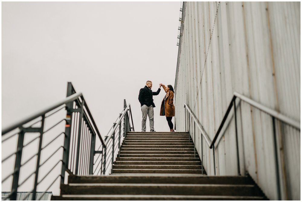 couple dancing on stairs granville island engagement emily carr university
