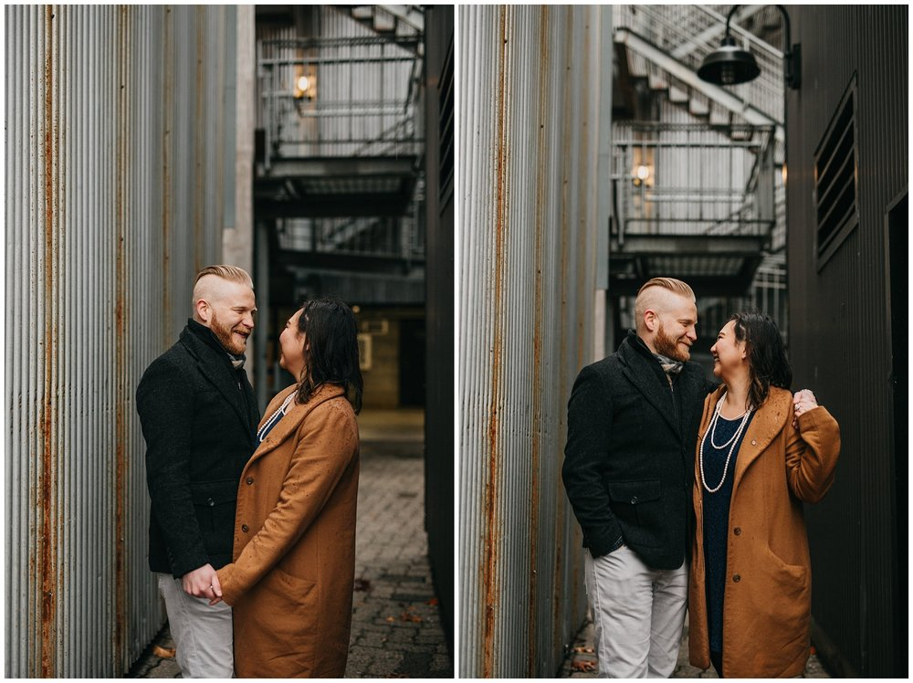 couple in industrial alley granville island vancouver engagement