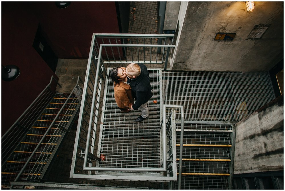 granville island engagement couple on metal stairs