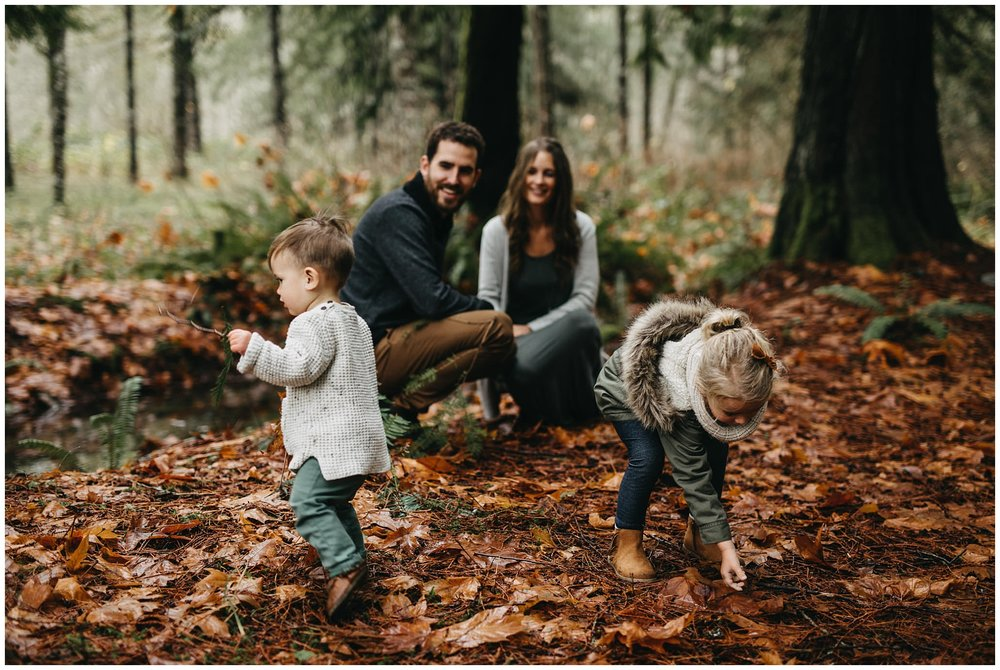 son and daughter kids playing with sticks and leaves chilliwack forest family