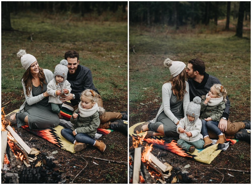 family sitting around campfire on blanket candid love chilliwack forest
