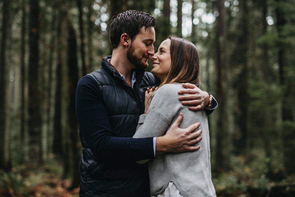 couple hug engagement session pacific spirit park forest
