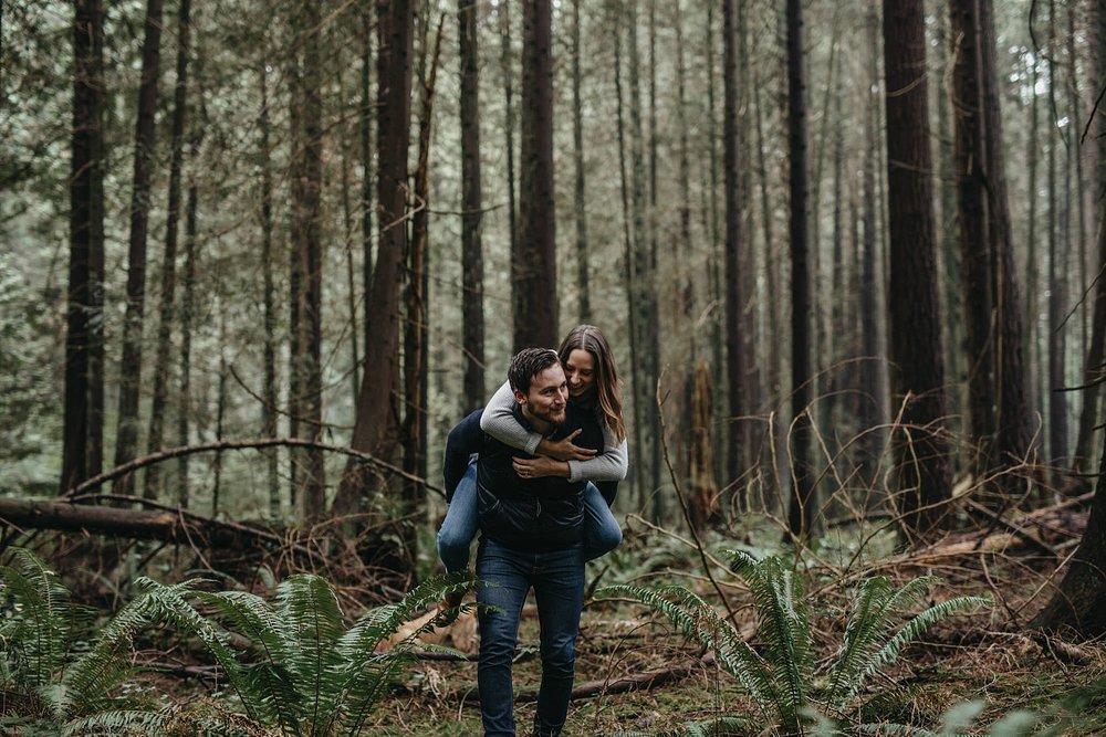 couple piggyback candid moment engagement pacific spirit park