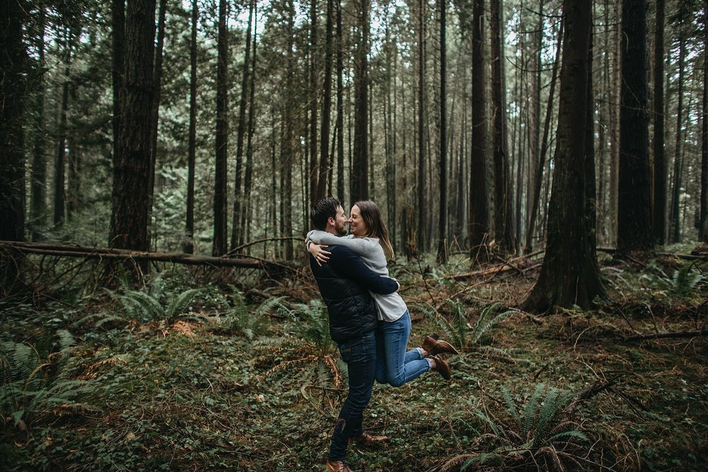 fiance engaged engagement photos pacific spirit park couple spinning