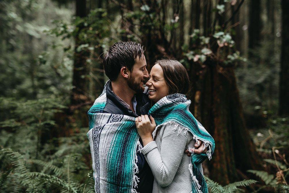 couple candid smile forest pacific spirit park engagement