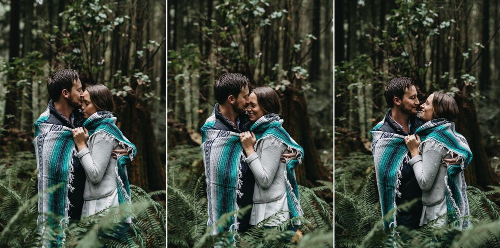 couple hug snuggle blanket forest pacific spirit park engagement
