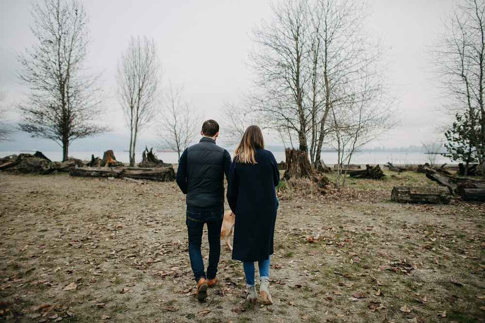 couple walking on beach spanish banks engagement