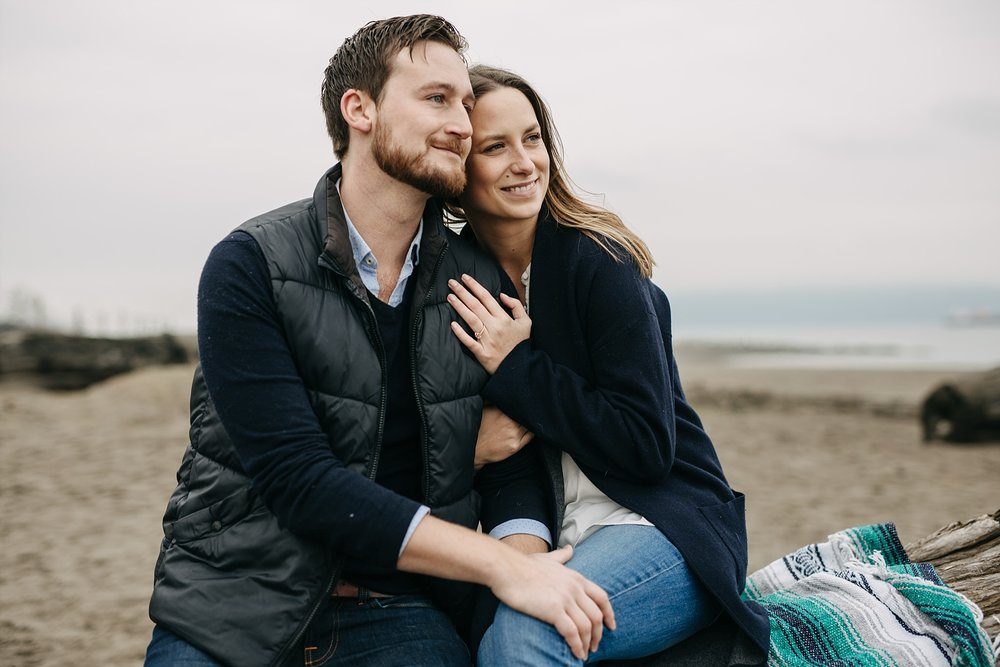 spanish banks beach engagement photos couple smiling
