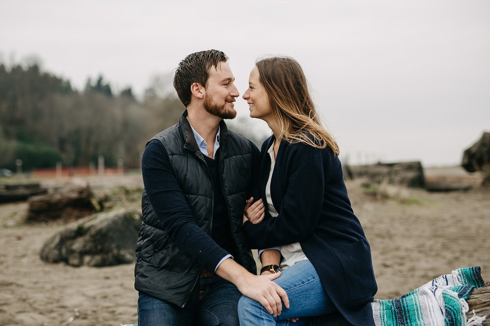 couple intimate moment spanish banks beach engagement blanket log