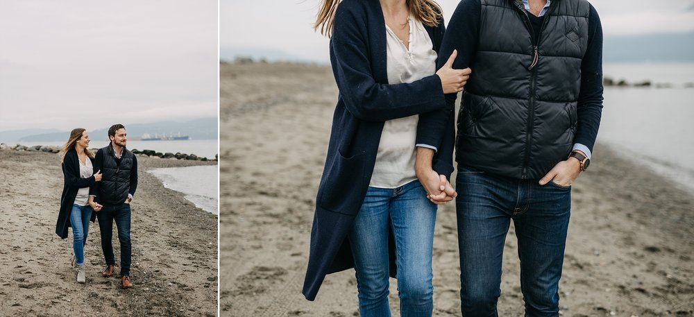 couple holding hands on beach walking spanish banks engagement