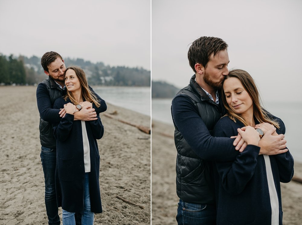 couple arms wrapped around each other spanish banks engagement beach