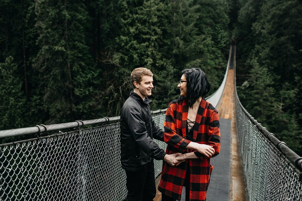 couple dancing on capilano suspension bridge engagement candid photos