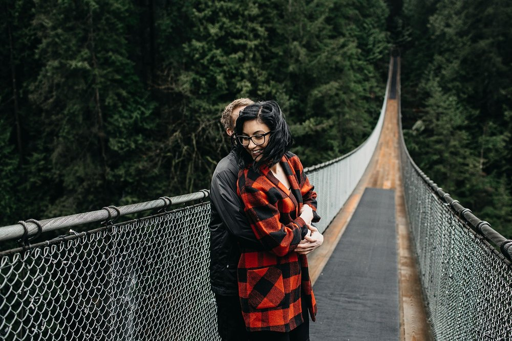 couple laughing candid moment engagement photos capilano suspension bridge