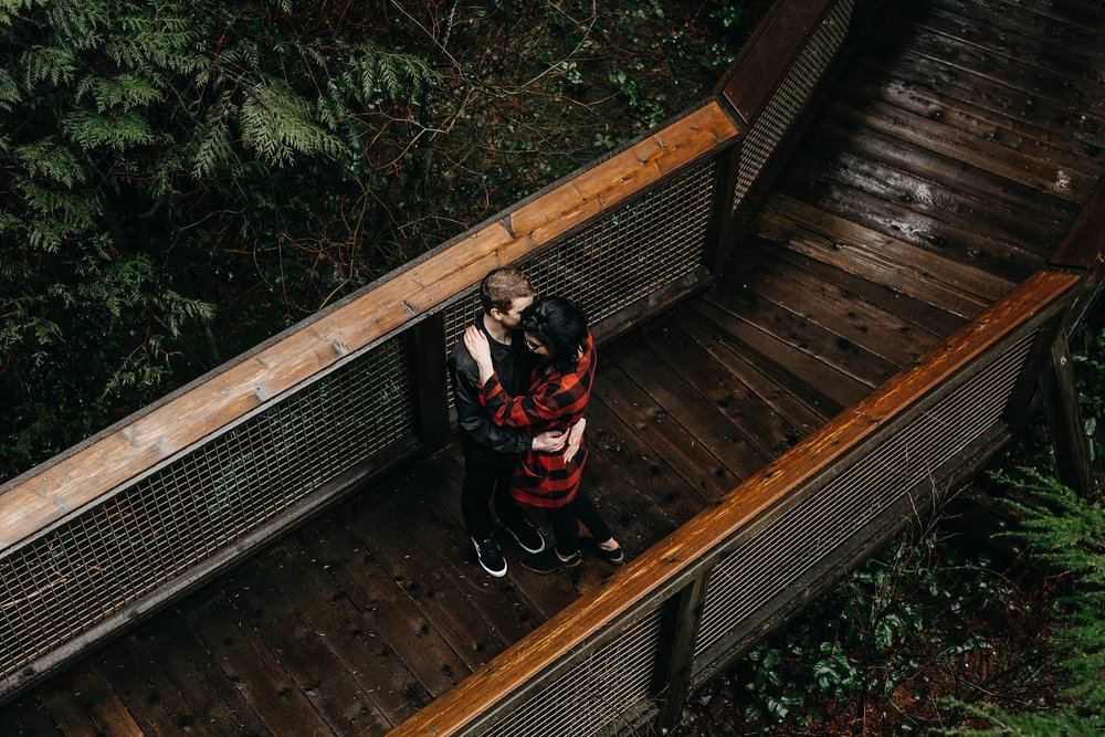 couple on nature's walk at capilano suspension bridge engagement photos
