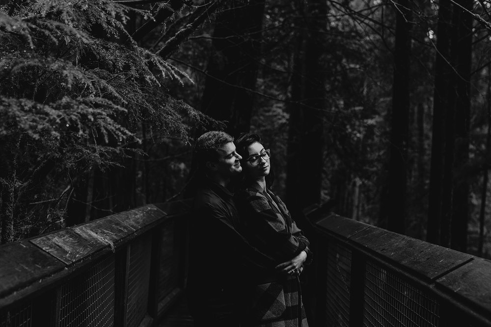 moody black and white couple engagement photos capilano suspension bridge