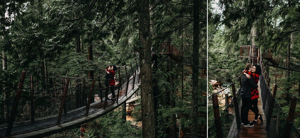 couple standing on bridge treetop adventures capilano suspension bridge