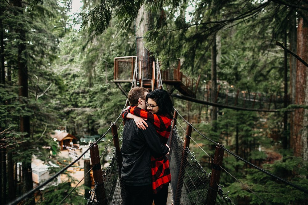 couple engagement photos tree top adventures capilano suspension bridge