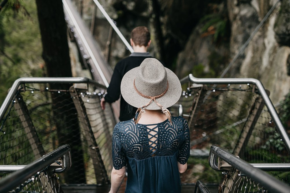couple walking to cliff walk capilano suspension bridge engagement photos