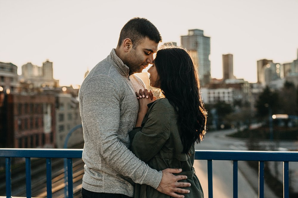 couple intimate romantic engagement session downtown vancouver sunset