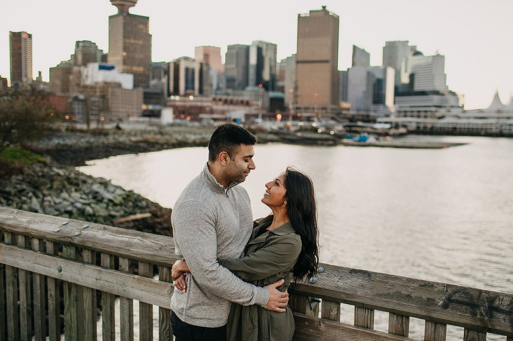 downtown vancouver waterfront engagement session couple on dock