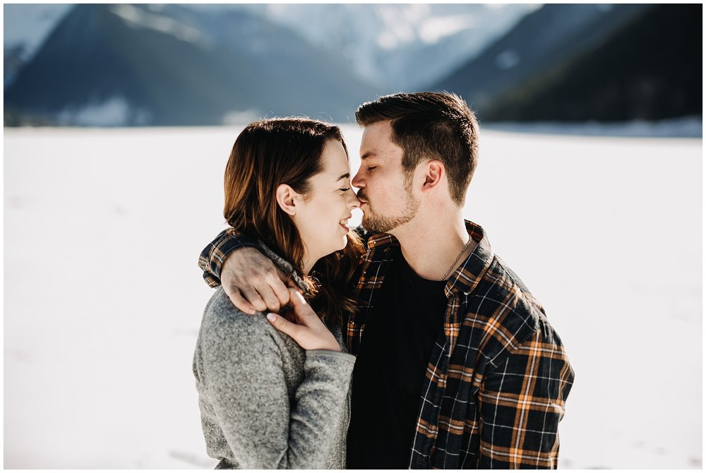 jones lake chilliwack engagement session snow mountains couple kiss on nose