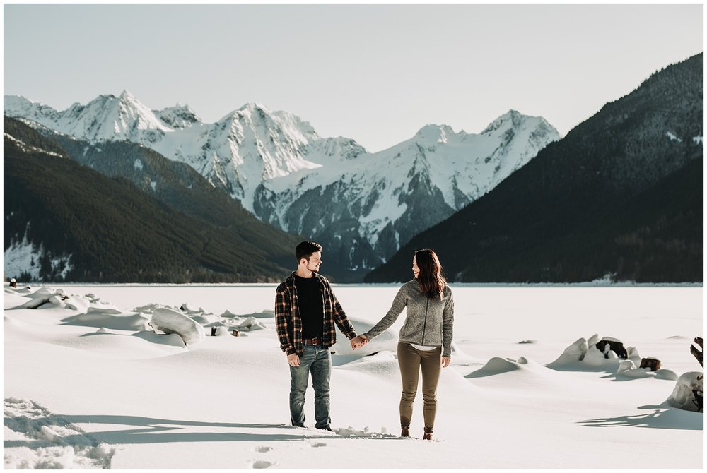 couple mountain view jones lake engagement session snow sun