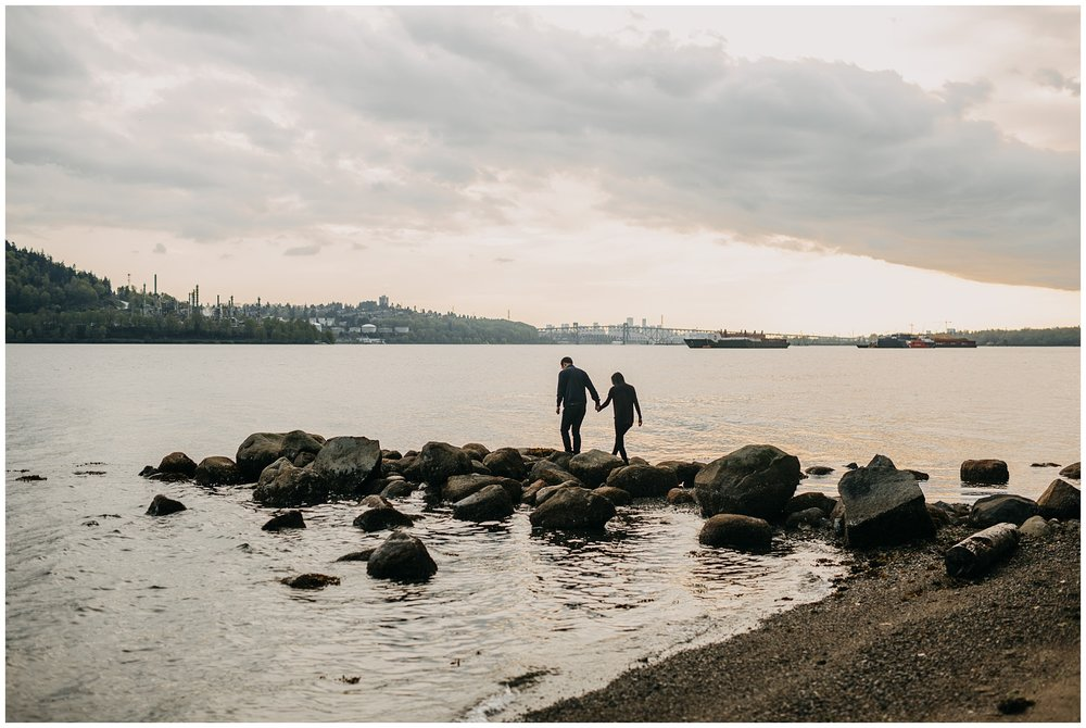 couple silhouette beach sunset rocks north vancouver engagement